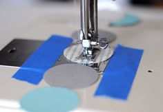 sewing paper garlands (use painters tape to help guide lines)