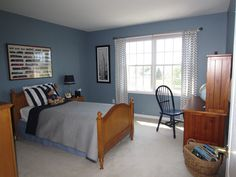 blue walls in boys bedroom | Paint Color - Amsterdam by Benjamin Moore)