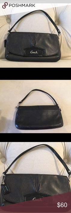 Black Leather Coach Mini Bag Black leather Coach mini bag, with back pocket, inside pocket and credit card slots. Black leather with black patent leather accents. Like new. No scratches, tears or stains. Coach Bags Mini Bags