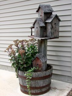 found this on FB -Green Renaissance page. love the idea! I have one of my Nanny's plants like this so just have to find the old birdhouses and a whiskey barrel!