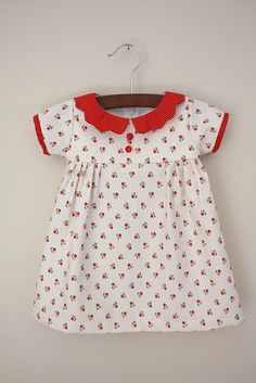 I adore vintage-style baby dresses.