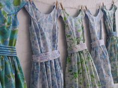 Perfect. Patterned bridesmaid dresses, 50s style, on pegs. Love love love