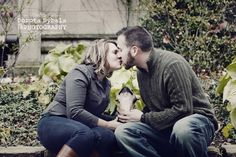 Cute french bulldog puppy and young couple kissing university of chicago campus engagement session