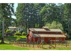 This spectacular near-15 acre Poulsbo farm is a rare opportunity to own open, sunny, level acreage with a stable, barn, quality fencing, a lovely 2,700 sq ft home, a guest house, and a pond.