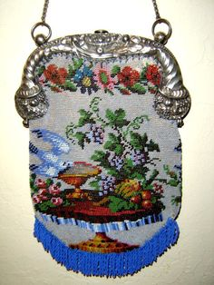 Micro beaded bird w/grapes motif. Notice the ends of the frame are also of similar theme. Barbara Jones Collection