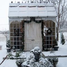 Pretty little garden shed, all dressed in snow.