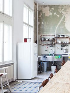 Industrial kitchen with rough walls | and high ceiling. I so want a loft. love the wood, white and light combo