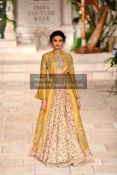 Mustard Yellow color designer jacket lehenga by Anju Modi from India Couture Week 2018. Contact us through WhatsApp +61470219564 or email to info@panachehautecouture.com to order or customisations.