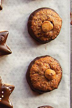 Nusstaler (Chocolate-Dipped Hazelnut Cookies) Recipe - Saveur.com