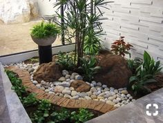Rock and plants for front by door