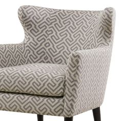 A modernized Greek key in elegant gray gives this scandinavian inspired, modern wing chair its chic appeal.