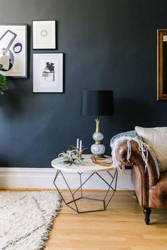 Modern Industrial Home Interior Design Inspiration featuring round coffee table used as end table next to brown leather couch with white throw, navy wall, boho rug Decoration Inspiration, Room Inspiration, Interior Inspiration, Decor Ideas, Room Ideas, Design Inspiration, Interior Ideas, Decorating Ideas, Home Living Room