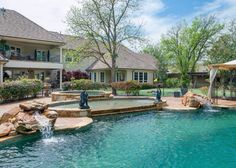 Outdoor space and pool. Love the rocks around the pool