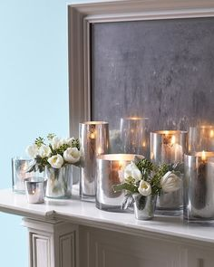 Paint fireplace ivory to coordinate with wallpaper and top with mercury glass votives and hurricane lamps (west elm)