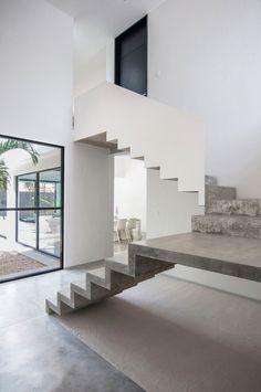 escalier en béton demi-tournant à palier intérmédiaire