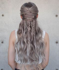 As impossible as this hairstyle looks, all you are doing is crisscrossing your hair in small sections and fishtailing as you go. You will be amazed how easy this really is once you check out the tutorial by Confessions of a Hairstylist.
