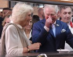 Britain's Prince Charles, Prince of Wales, and the Duchess of Cornwall, Camilla, stand at the bar in the market of Sant' Ambrogio [AFP/Getty Images]