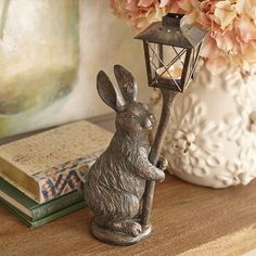 Our antiqued, bronze-colored garden statue holds an iron and glass lantern to help you shed a little tealight on the porch, patio or yard. Crafted of lightweight resin so you can easily move it indoors or out, our bunny is a Pier 1 exclusive. Pretty clever, huh?