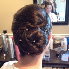 For super thick hair, try incorporating braids into your style to help the style hold and to minimize how large the updo gets! This bride of mine has very thick hair down past her bra line!