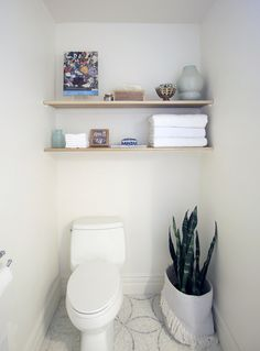 I love open shelving in a bathroom! It's a great place to tuck extra towels and toilet paper and to display some color and accessories.