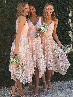 Pink tea length bridesmaid dresses. Spaghetti strap v neck junior bridesmaid dress with asymmetrical hem.