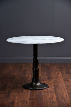 Brenda Round Bistro Table With Cast Iron Base And White Marble Top No  Additional Finish Or