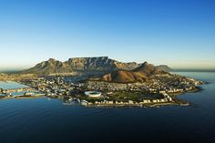 Aerial view of Capetown Table Mountain South Africa. An aerial view of Capetown , Australia Occidental, Little Passports, Cape Town Hotels, Kairo, V&a Waterfront, Contemporary African Art, Table Mountain, Cultural Experience, Aerial View