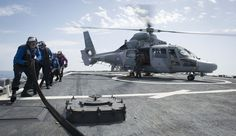 MEDITERRANEAN SEA (May 18, 2017) Sailors retract a refueling line from a French navy Panther anti-submarine helicopter assigned to the Cassard-class anti-air frigate FS Jean Bart (D615) during flight quarters aboard the Arleigh Burke-class guided-missile destroyer USS Ross (DDG 71). Ross is forward-deployed to Rota, Spain, conducting naval operations in the U.S. 6th Fleet area of operations