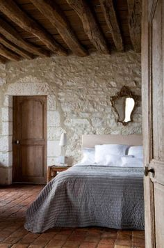 beautiful tommettes on the floor, pointed stone walls & original beams