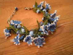 blue bracelet with needle lace flowers and  beads by PashaBodrum