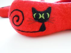 I've wanted these for a while. Felted bright red color slippers BLACK CAT. $76.00, via Etsy.