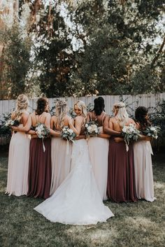 We love the contrasting fall tones of these bridesmaid dresses | Image by Jonnie + Garrett Wedding Photographers