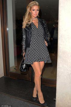 What a beauty: On Wednesday, Paris Hilton slipped on a printed mini dress with nude nylons for a night out on the town in London