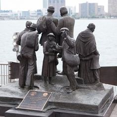 """Detroit Historical Marker: """"Gateway to Freedom,"""" Hart Plaza, Detroit, Michigan, by sculptor Ed Dwight. Depicts slaves looking toward Canada and freedom. Paying 'homage' to the difficult travels many African American slaves made in the 1800s on the Underground Railroad— and people who took great risks helping them to freedom when they made it North to Detroit. The Underground Railroad helped thousands of escaped slaves make their way to free states or Canada."""