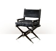 "A Director""s chair, the woven embossed leather slung backrest between turned uprights with stainless steel finials, the wrapped arms and seat supports with stainless steel roundel ends, with a slung and loose cushion Boodles leather seat, on ebonised mahogany crossover legs with stainless steel cappings and stretchers."