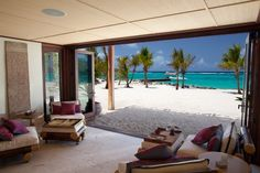 We are guests of Richard (Branson) this week, just a little rest before Christmas, and this is our our sitting room at his Necker Island beach house.