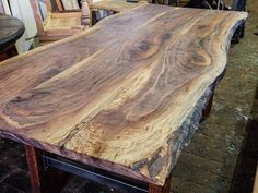 Stunningly gorgeous live edge walnut top... We build any size, style, or design!