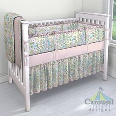 Crib bedding in Love Bird Damask, Pink Circles, Love Birds, Baby Pink Chenille. Created using the Nursery Designer® by Carousel Designs where you mix and match from hundreds of fabrics to create your own unique baby bedding. #carouseldesigns