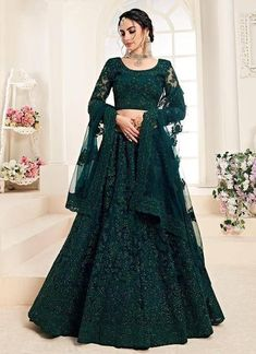 It's colour and fabric is too good,the overall beauty of this dress is mind blowing and you'll definitely love this lehenga. #green #embroided Green Lehenga, Net Lehenga, Lehenga Choli Online, Bridal Lehenga Choli, Indian Lehenga, Anarkali, Lehenga Top, Heavy Lehenga, Gold Lehenga