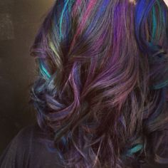 Highlighted mermaid hair. Pravana color blue, violet, green, and a mix of magenta and red :)