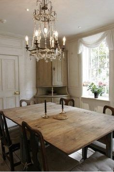 French Country Home - the colors and the wood mixed with the formality of the chandelier - yummy