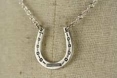 Silver Horseshoe Necklace, Vintage Pendant, Western Jewelry, Simple Necklace, Good Luck, Lucky Horse Shoe. $25.00, via Etsy.