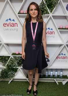 Pretty as a picture: Earlier in the day Natalie modelled her pretty ensemble in the evian ...