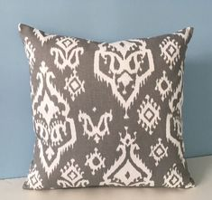 A personal favorite from my Etsy shop https://www.etsy.com/listing/569875825/gray-and-white-ikat-throw-pillow-modern