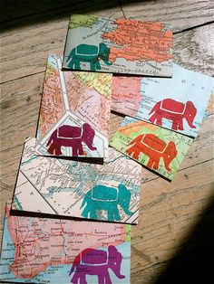 Envelopes... these would even be wonderful in small picture frames.. even to combine this idea with the map chair idea.. hmmm I love all of the possibilities!!