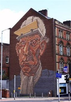 Opposite the Co-op's Castle Street entrance, a drab gable end has been transformed by a 1986 brick mural, the Steelworker by the artist Paul Waplington. It was constructed by Sheffield'sCity Works Department using eighteen different types of brick from eight manufacturers, the total number of bricks being about 30,000.