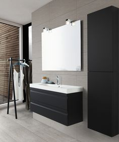 Dansani Menuet washbasin - not so deep - quite smart anyhow. Furnishing Tip! Use two wall cabinets placed on top of each other - a smart alternative to a deep tall cabinet.