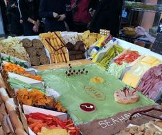 Fill the bins to the brim. | How To Build A Super Bowl Snack Stadium