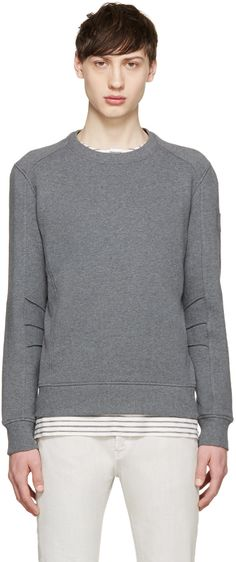 Long sleeve French terry sweatshirt in heather charcoal grey. Rib knit crewneck collar, cuffs, and hem. Panelling at sleeves. Rib knit panel at side seams. Tonal stitching.