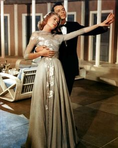 GRACE KELLY in High Society (1956) wearing a chiffon embroidered gown, designed by MGM costumer Helen Rose (who also designed her wedding gown).